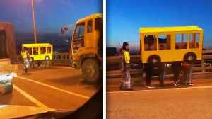 People Disguised as Bus Try to Cross Vehicles-Only Bridge on Foot [Video]