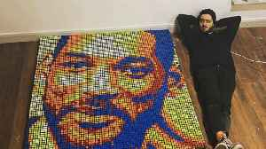 Artist painstakingly creates giant portraits of celebrities using hundreds of twisted rubik's cubes [Video]