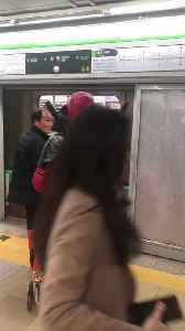 Man in red deadpool costume on nyc train [Video]