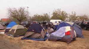 With nowhere to go, wildfire evacuees set up camp in Walmart parking lot [Video]