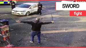 Police confront man waving 'samurai sword' on a street in broad daylight [Video]