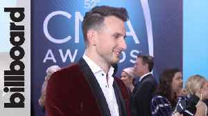 Russell Dickerson Talks Chart Success, Wanting to Work With Ariana Grande at 2018 CMA Awards   Billboard [Video]