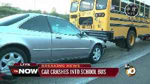 Car crashes into school bus [Video]