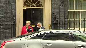 UK's Theresa May leaves Downing Street to address parliament