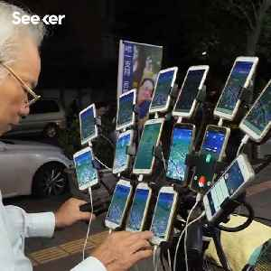 Pokémon Grandpa' Uses 15 Phones at Once for Pokémon Go [Video]