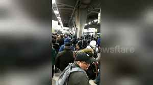 Commuter chaos at George Washington Bridge bus station during snowstorm [Video]