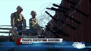 Soldiers take on fortifying border, awaiting migrant caravan [Video]