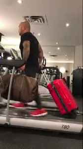 Man prepares for trip by running on treadmill with luggage [Video]