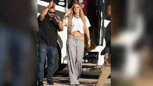 Jennifer Lopez Turns Heads in Low-Cut Grey Pants with Attached, Matching, Visible High-Cut Thong [Video]