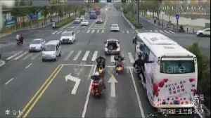 Chinese man hangs on the side of moving coach for promotional campaign [Video]