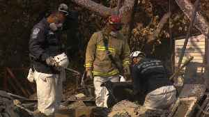 Search crews rush to find wildfire victims before rain moves in [Video]