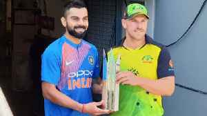 News video: India VS Australia 1st T20: Virat Kohli, Aaron Finch pose with trophy ahead of match |वनइंडि