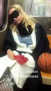 Girl asleep subway hand clapper basketball costume key west [Video]