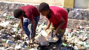 Where children search through rubbish for food [Video]