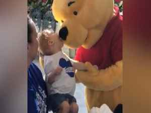 WARM YOUR HEART! Winnie the Pooh shares special moment with disabled child at Walt Disney World - ABC15 Digital [Video]