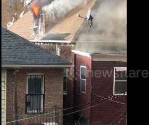 Huge fire tears through multiple homes in New York City [Video]