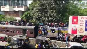 Indian pilgrims surf train in huge numbers en route to holy festival [Video]