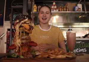 Beauty and the Beast: Model Beats Monster Burger Challenge [Video]