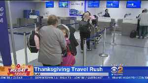 Travelers Put Up With Traffic, Flight Delays During Thanksgiving Travel Rush [Video]