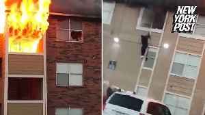 Six people, including a baby, forced to jump out of burning building [Video]