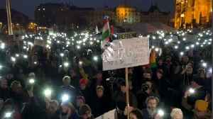Hungarians march against Soros university closure plans [Video]