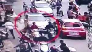 Confused Woman Driver Ploughs Through Crowd [Video]