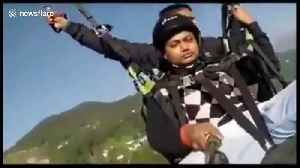 Horrifying moment a paraglider snaps mid-air, killing one and injuring another [Video]