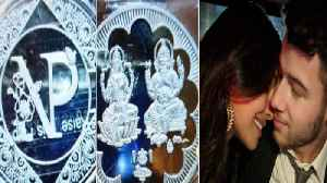 News video: Priyanka - Nick wedding: Couple designed THIS special customised return gifts for guest | FilmiBeat