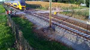Cyclist escapes death on unguarded train level crossing [Video]