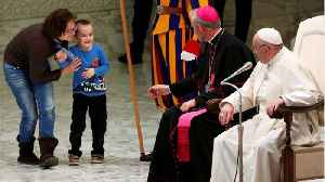 Young Boy Plays At The Feet Of Pope Francis [Video]