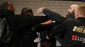 Deontay Wilder and Tyson Fury get into shoving match (WARNING: graphic language) [Video]