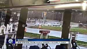Man running from police charged in deadly crash [Video]