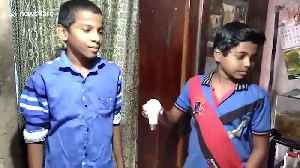 Wonder boy lights LED bulbs without electricity by touching them with his hands [Video]
