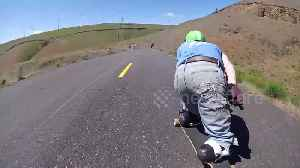 US double amputee hurtles down hill on skateboard after overcoming horror train accident [Video]
