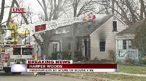 Firefighters at scene of house fire in Harper Woods [Video]