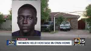 Phoenix women held hostage as armed suspect hides from police [Video]