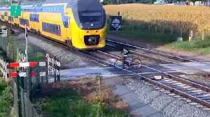 Cyclist Has Shockingly Close Call At Level Crossing [Video]