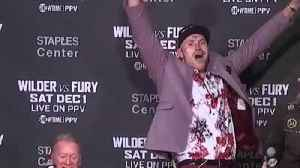 Watch Fury sing at post-fight news conference [Video]