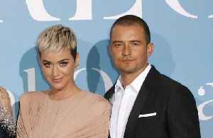 News video: Katy Perry outbids fan for date with Orlando Bloom