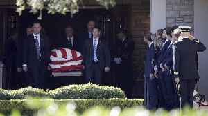 Bush's casket travels from Houston to D.C. [Video]