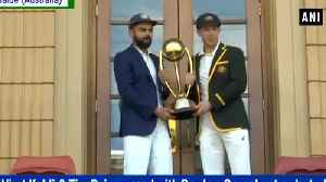 India vs Australia 1st Test : Virat Kohli and Tim Paine pose with the Border–Gavaskar Trophy [Video]