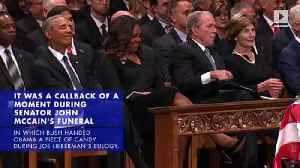George W. Bush Gives Michelle Obama Candy at His Father's Funeral Service [Video]