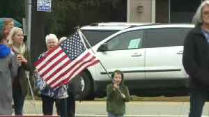 Pint-sized patriot holds flag as he waits for George H.W. Bush's funeral train to pass by [Video]