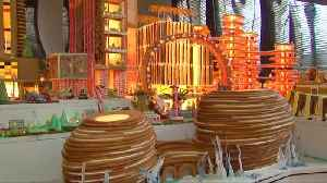 Delicious! Architects build edible gingerbread city [Video]