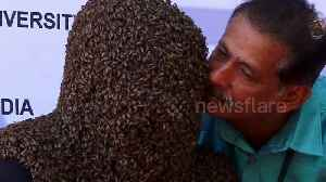 Indian man wins world record for wearing 60,000 bees on his face for four hours [Video]