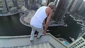 Man Performs Some High-Rise Stunts [Video]