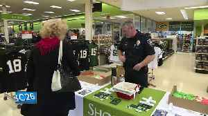 Shop with a Cop donation drive helps children in need buy holiday gifts [Video]