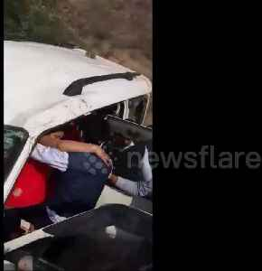 Indian police rescue six people trapped in car which fell off bridge [Video]