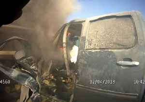 'I'm Bleeding, Help Me!' - Deputy and Bystanders Come to Rescue of Driver Trapped in Burning Truck [Video]