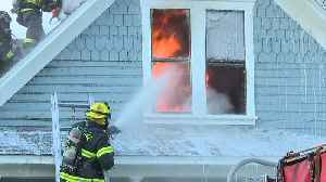 Caldwell firefighters rescue a man from a burning home [Video]